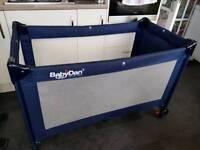 Blue travel cot