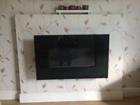 Black glass fronted gas fire.