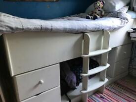 White single bed with lots of storage