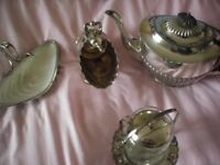 silver plates tea pot and extras
