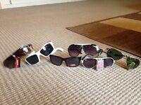 6 pairs of designer sun glasses 2 carrera 3 ray ban and 1 Oakley