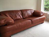 Two tan leather sofas