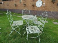 ABSOLUTELY STUNNING CAST IRON GARDEN SET (TABLE AND 4 CHAIRS)