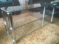 Large clear glass and stainless steel TV unit