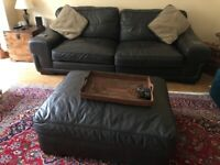 2 x brown leather sofas and matching footstool - excellent condition