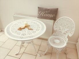 Attractive circular White ornate metal table and chair