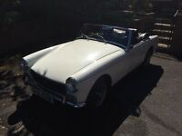 MG Midget Convertible for sale. Well loved, slightly rusty but a good runner. MOTd Feb