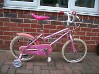 "Girls bike with 14"" wheels and stabilisers"
