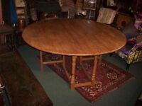 Magnificent circular oak gateleg table - seats 8