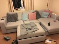 Sofa with double sofa bed, right facing chaise long and large foot stall with storage