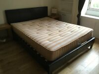 King size bed. Complete with mattress. In good condition.