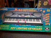 Casio electronic keyboard with lights