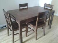 Marks & Spencers dining table and four chairs