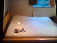 Super kingsize bed.