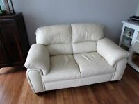 Cream, genuine leather 2 seater sofa.