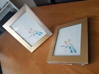 2 wooden Gold coloured Photo frames.