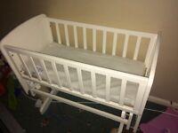 Baby white glider crib