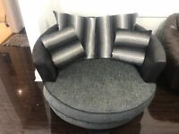 CUDDLE/SWIVEL CHAIR....GREY AND BLACK