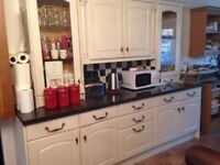 Oak and cream kitchen units with granite work tops