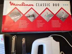 Moulinex electric carving knife- for roast meat and separate blade for bread.