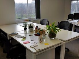 Desk space in shared creative central office
