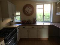 Kitchen units complete with wood worktop and sink