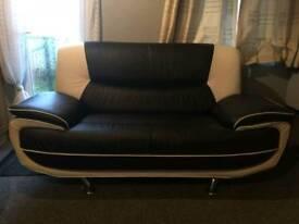 Black and cream 2 seater sofa