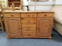 Excellent condition pine sideboard with 6 drawers, 2 cupboards, and bun feet