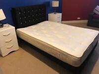 Grey velvet bed with diamanté head board