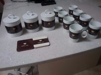 8 matching coffee mugs Tea,Coffee,Sugar canisters