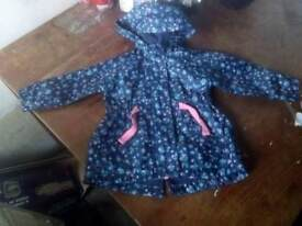 Blue flowery patterned 6-9 months raincoat. £3