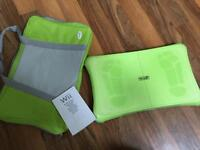 Wii fit board including non slip cover, instruction manual and carry case.
