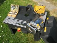 Router with a router table and box of 12 router bits