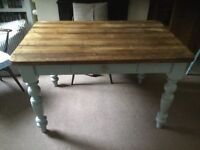 Rustic farmhouse table with drawer. Grey blue legs with distressed finish.