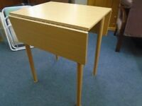 small pine look drop leaf table.