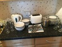 Kettle, toaster, dishes, glasses and cutlery
