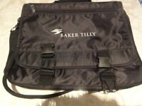Black satchel with many compartments