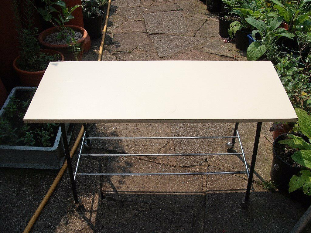Small Sturdy table ( good condition) On Casters