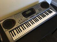Casio Keyboard. Good condition, no power supply but works fine. 248 tones, 104 rhythms,!