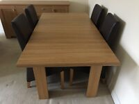 As new extending dining room table and 4 chairs