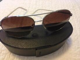 Unisex prada aviator sunglasses.