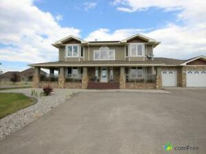 $990,000 - Acreage / Hobby Farm / Ranch in M.D. of Foothills