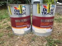 Two unopened cans of Dulux weather shield textured masonry paint - Luna Grey