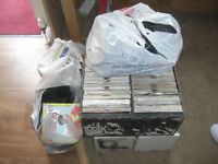 Large lot of vinyl singles in three boxes and three bags.