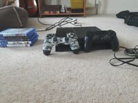 Selling PS4 with 5 games and 2 controllers