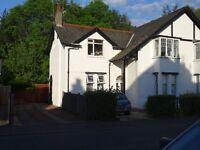 Lovely, unfurnished two bedroom cottage flat for rent in Milngavie, with own driveway and garden