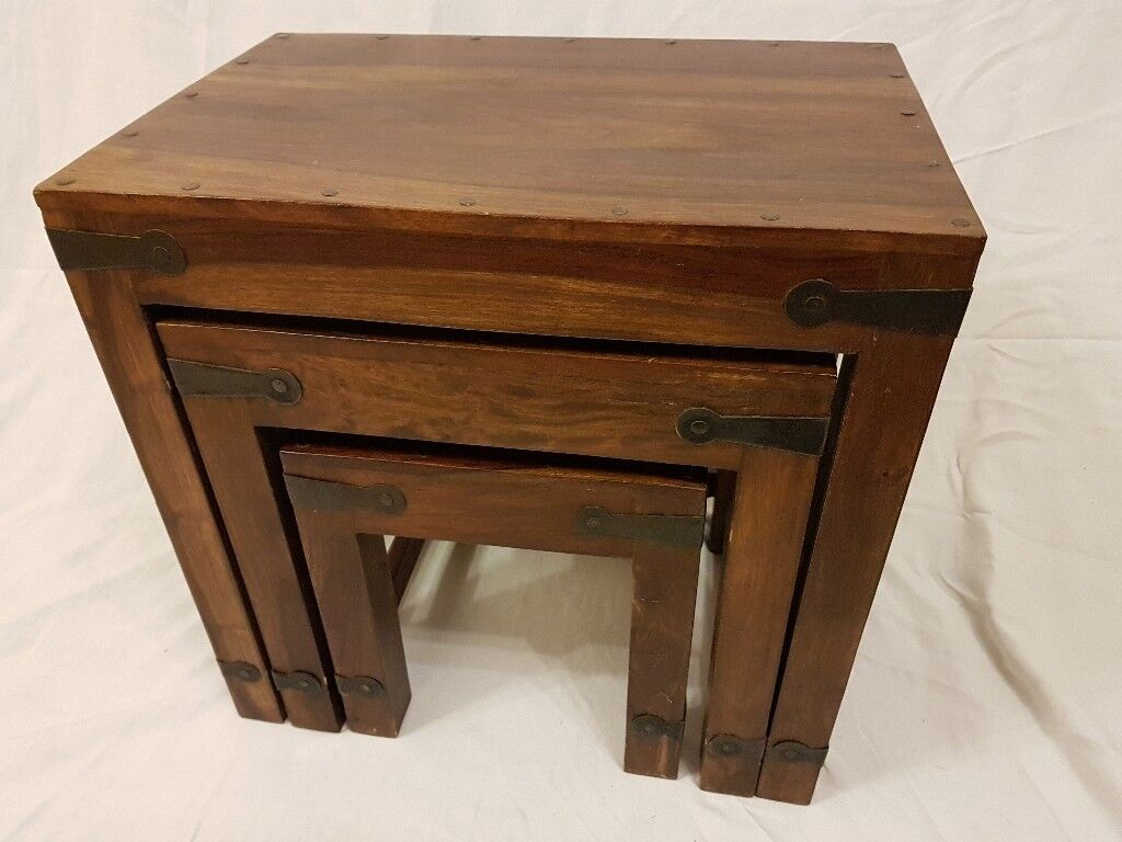 Nest of three wooden coffee tables.