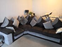 L shape black and grey sofa and swivel chair