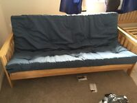 Pine Futon in great condition. Previously used as a guest bed/sofa in a spare room