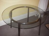 Glass dining table for sale.